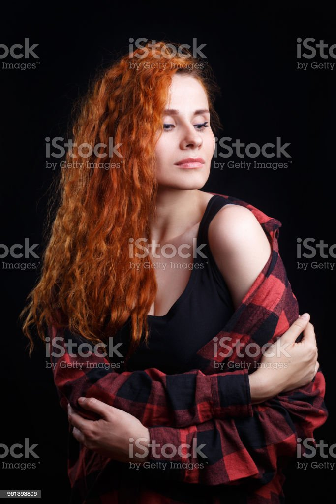 Young attractive doubting stressed woman with red curly hair iso stock photo