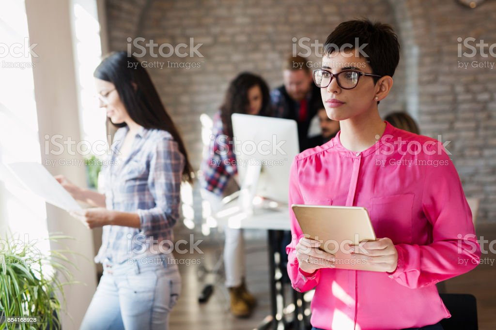 Young attractive female architect using digital tablet royalty-free stock photo