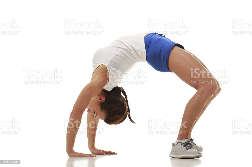 Young attractive female fitness model in bridge royalty-free stock photo