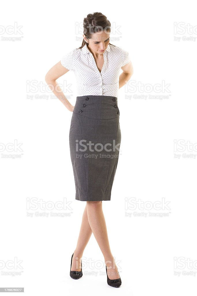 young attractive female fixes her skirt, isolated on white stock photo