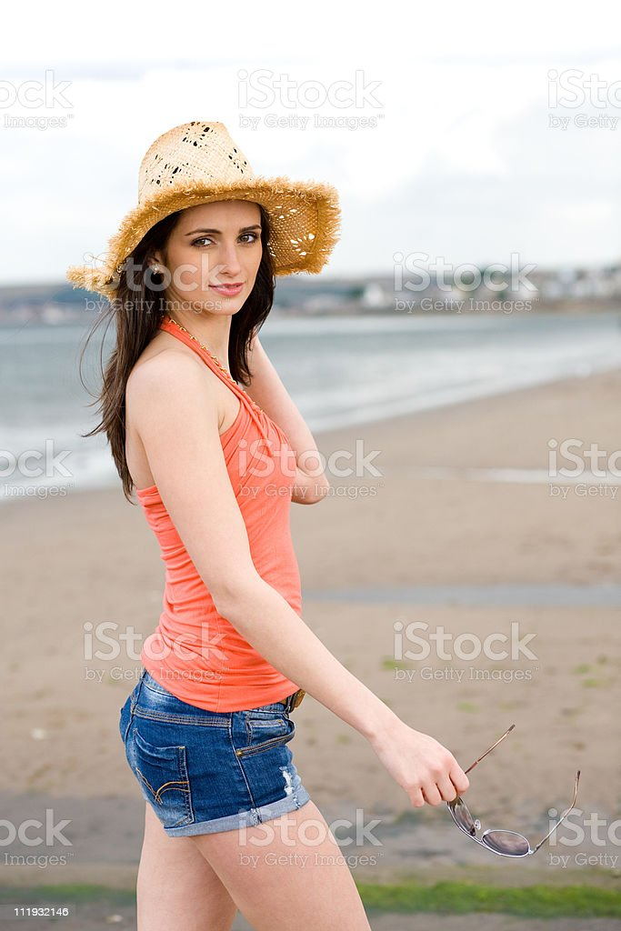 young attractive female in straw hat relax at sea front stock photo