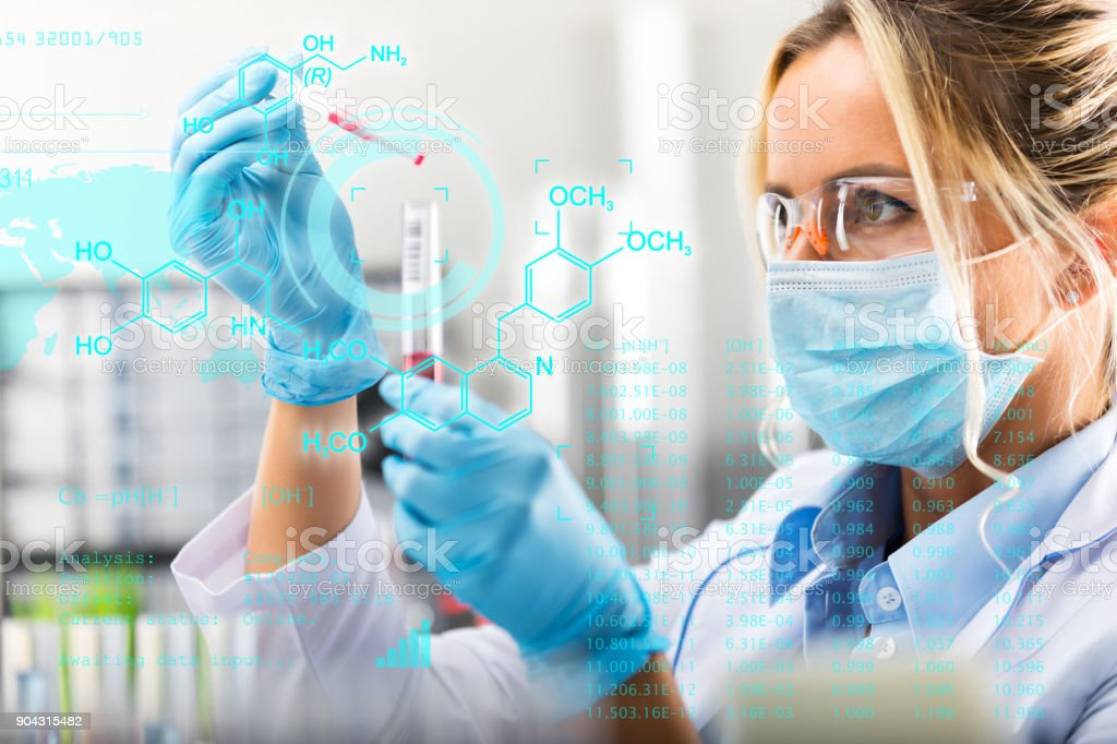 Young attractive female scientist researching in the laboratory stock photo