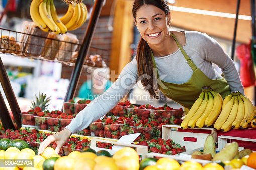 istock Young attractive fruit market saleswoman 690422704