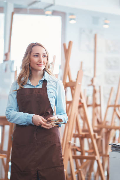 Young attractive girl in the art shop stock photo