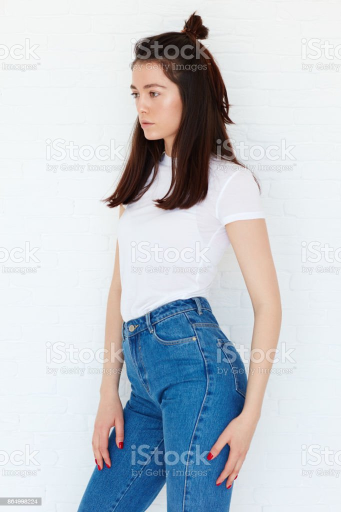 young attractive girl posing on model test shoot with natural day light stock photo