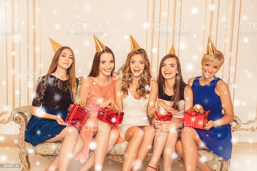 Cтоковое фото Young attractive girls with presents having xmas party