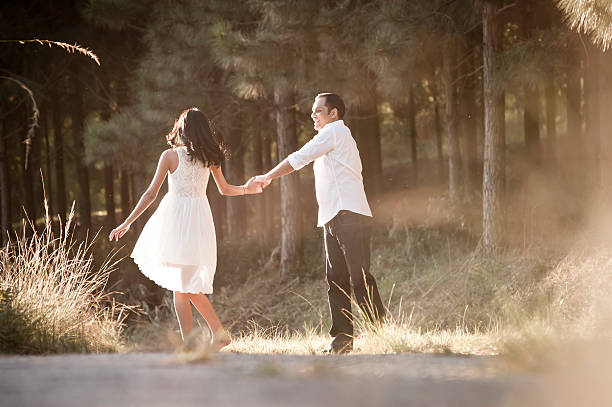 Young attractive indian couple outdoors wearing white Young attractive indian couple outdoors wearing white romance stock pictures, royalty-free photos & images