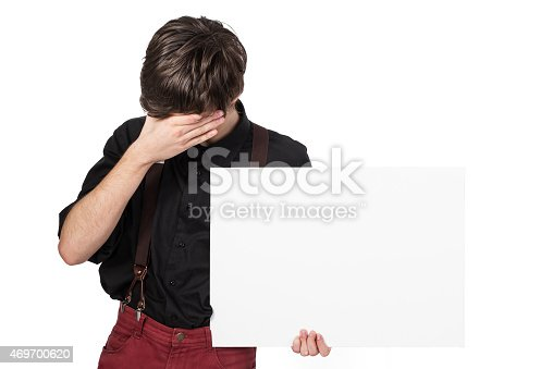 528291188 istock photo Young attractive male holding a white sign, unhappy 469700620