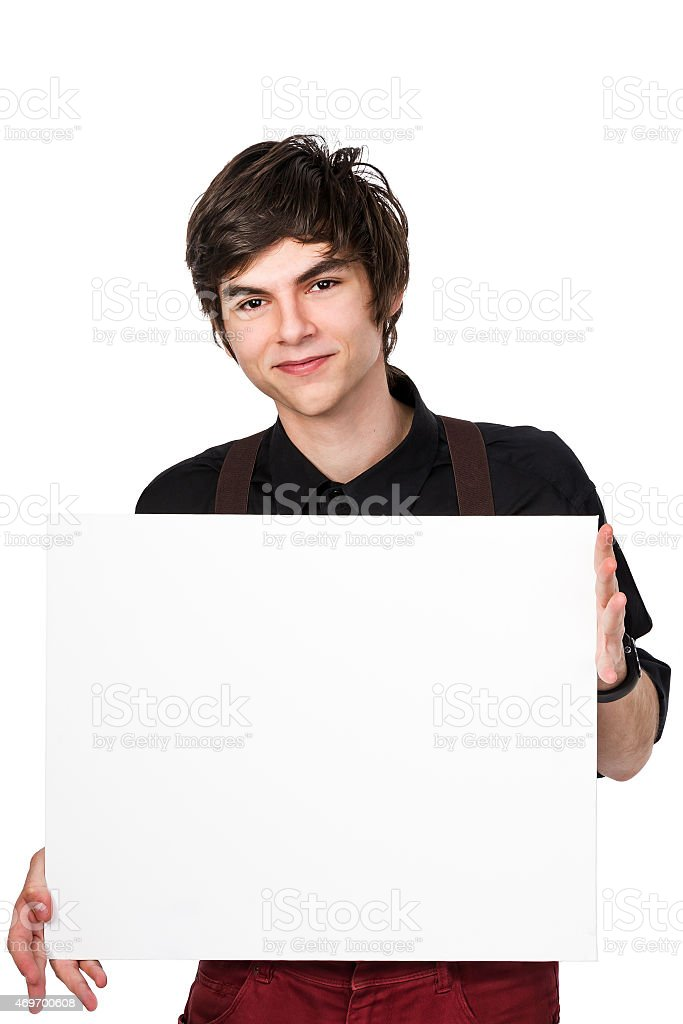 Young attractive male holding a white sign with positive expression stock photo