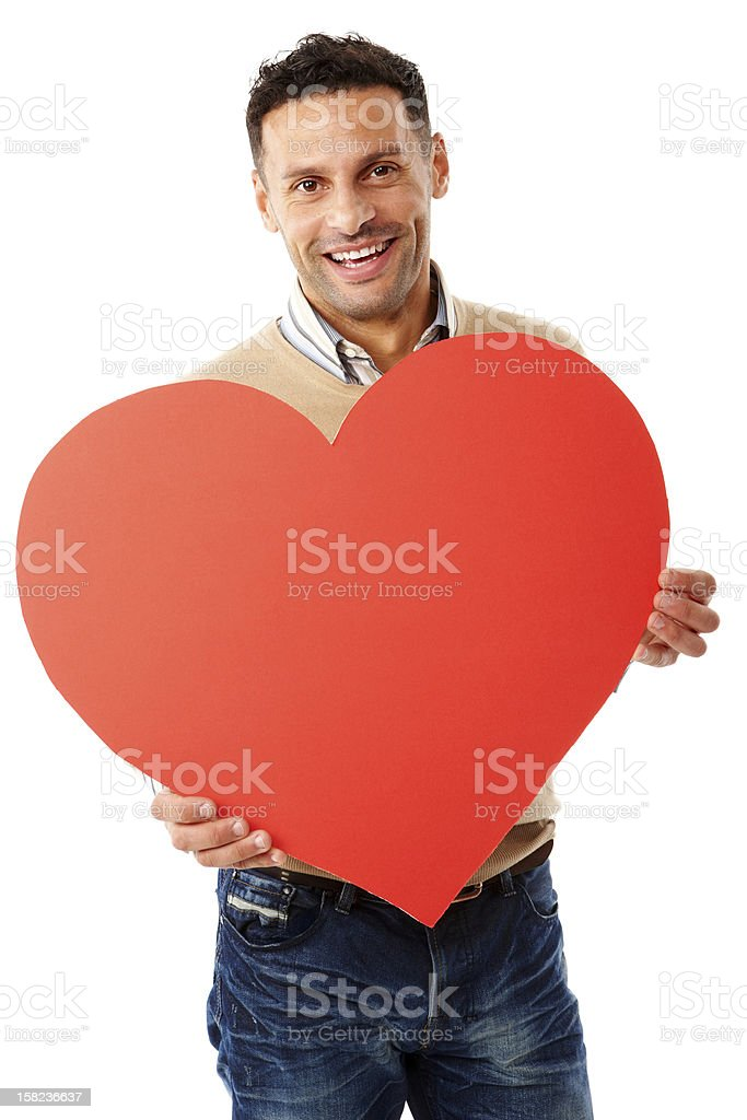 Young attractive male holding heart shape royalty-free stock photo
