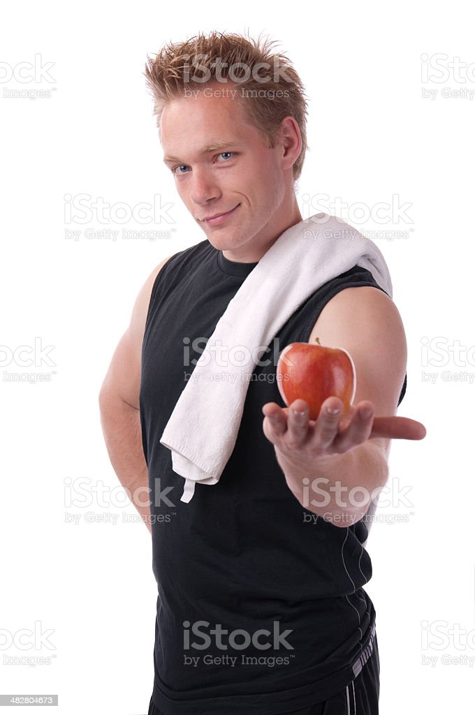 Young attractive man holding an apple stock photo