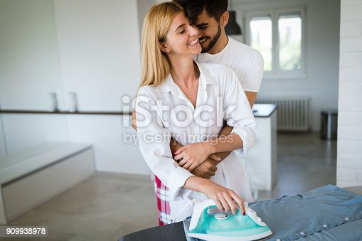 802472024istockphoto Young attractive man hugging his beautiful girlfriend 909938978