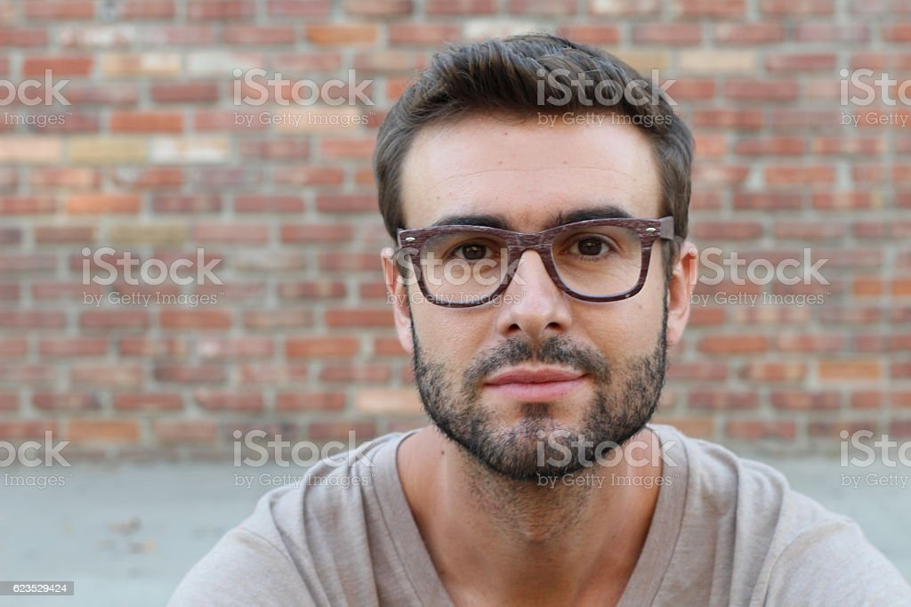Young attractive man looking at camera stock photo