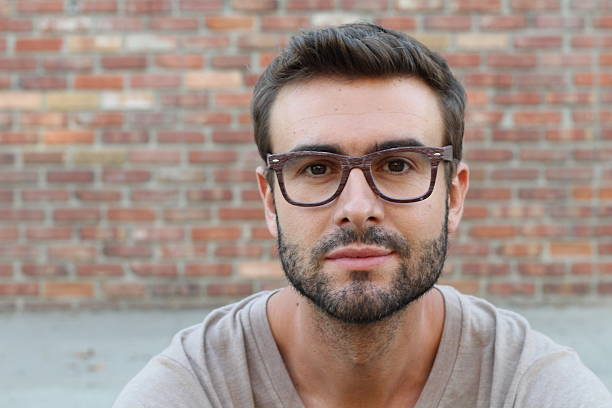 young attractive man looking at camera - close to stock pictures, royalty-free photos & images