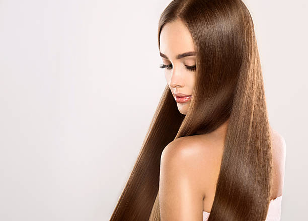 Young attractive model with gorgeous, shiny, long, straight hair. stock photo