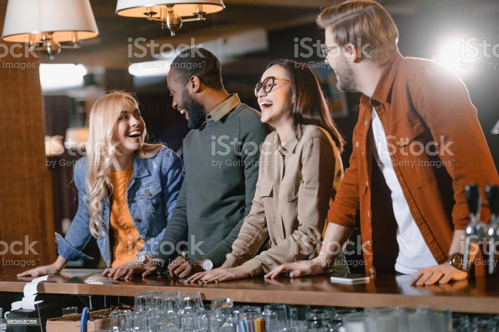 young attractive multiculture company of friends at bar - Royalty-free Adult Stock Photo