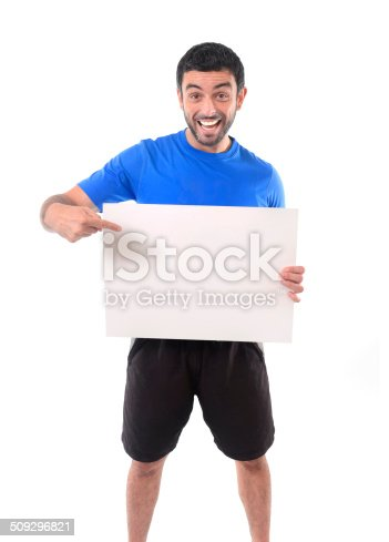 istock young attractive sport man holding blank billboard as copy space 509296821