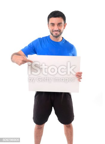 istock young attractive sport man holding blank billboard as copy space 509296905