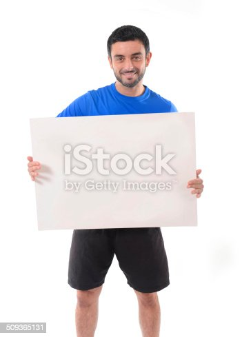 istock young attractive sport man holding blank billboard as copy space 509365131