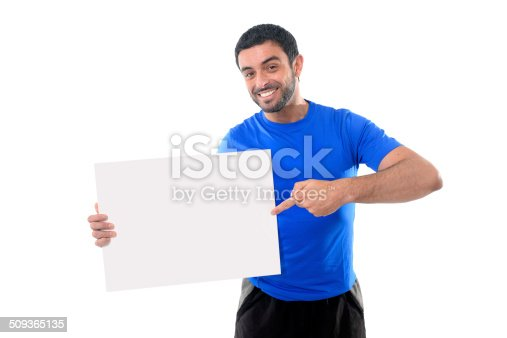 istock young attractive sport man holding blank billboard as copy space 509365135