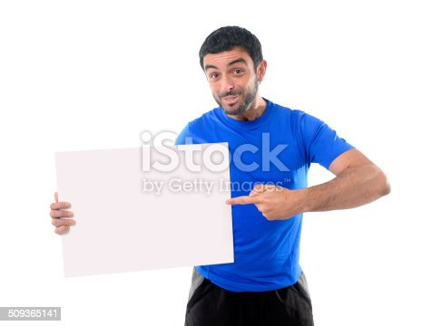 istock young attractive sport man holding blank billboard as copy space 509365141