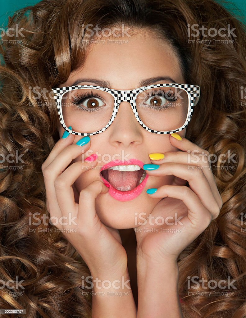 Young attractive surprised woman wearing glasses stock photo