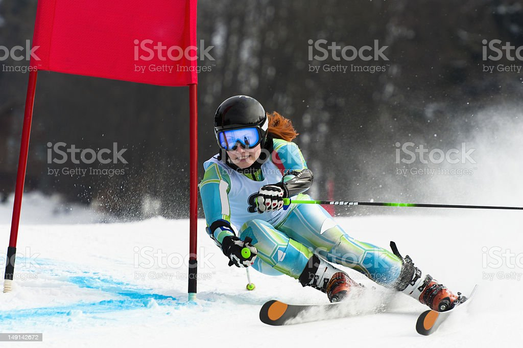 Young attractive woman at giant slalom race stock photo