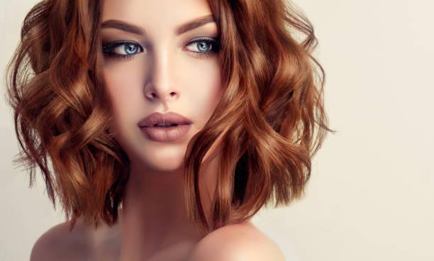 young attractive woman brunette with short wavy hairstyle. - figura femminile foto e immagini stock