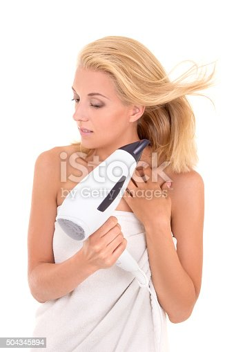 639833996istockphoto young attractive woman drying her hair with hairdryer 504345894