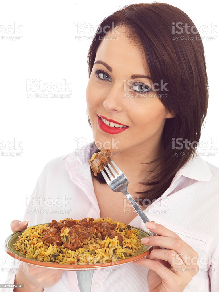 Young Attractive Woman Eating Lamb Rogan Josh Indian Curry stock photo