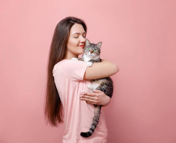 Young attractive woman hugging cat in hands pink background picture id1132429315?b=1&k=6&m=1132429315&s=612x612&w=0&h=6tkn5g9 vr3sns8st9dzt9cupjvskodnarzx1dbktvm=