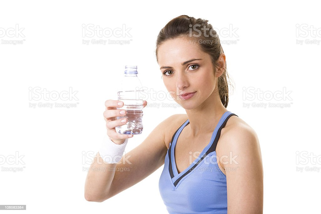 young attractive woman in fitness top holds water bottle, isolated royalty-free stock photo