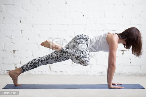 istock Young attractive woman in Plank pose, variation, white studio 639592512