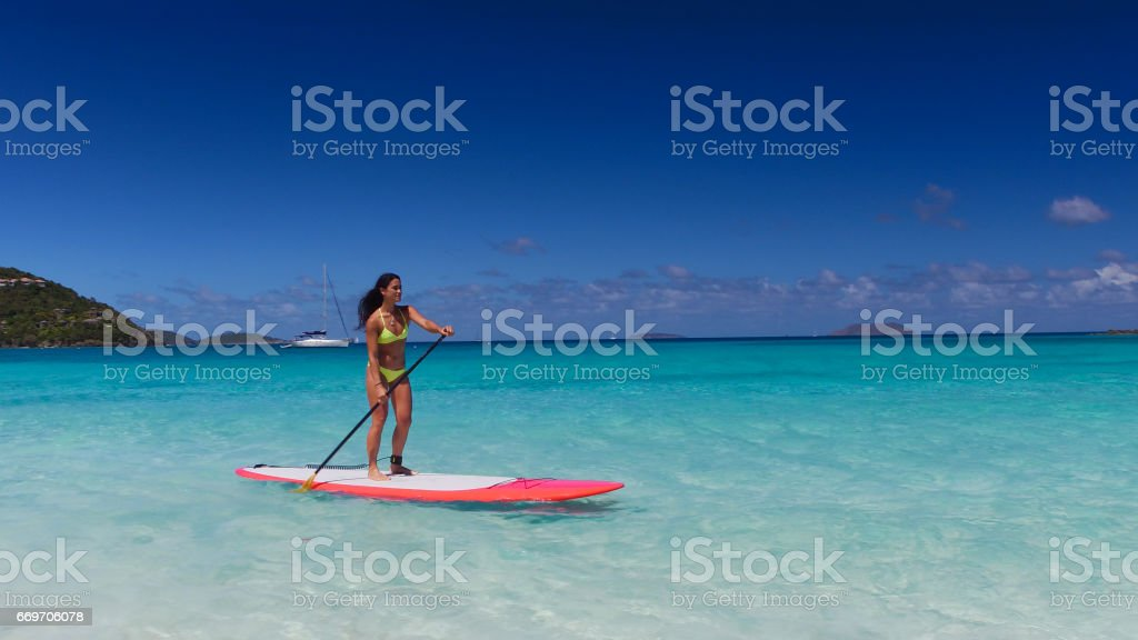 young attractive woman on paddleboard stock photo