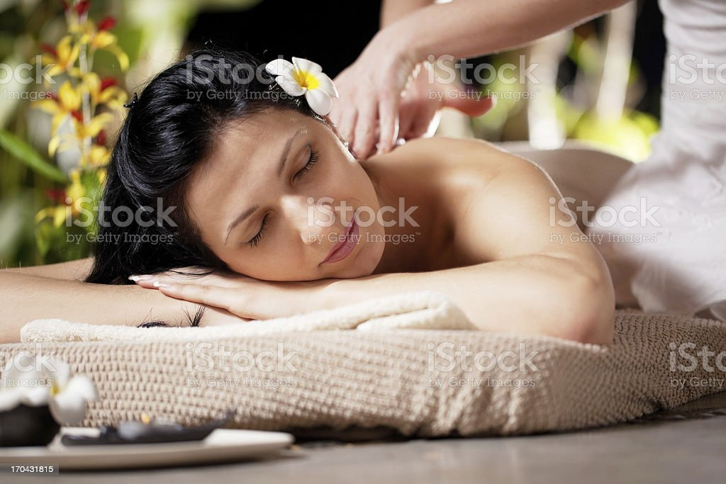 Young attractive woman receiving massage at spa resort royalty-free stock photo