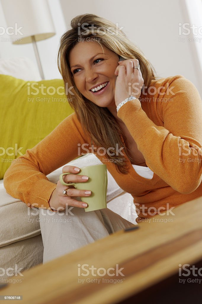 young attractive woman relaxing and talking on telephone at home royaltyfri bildbanksbilder