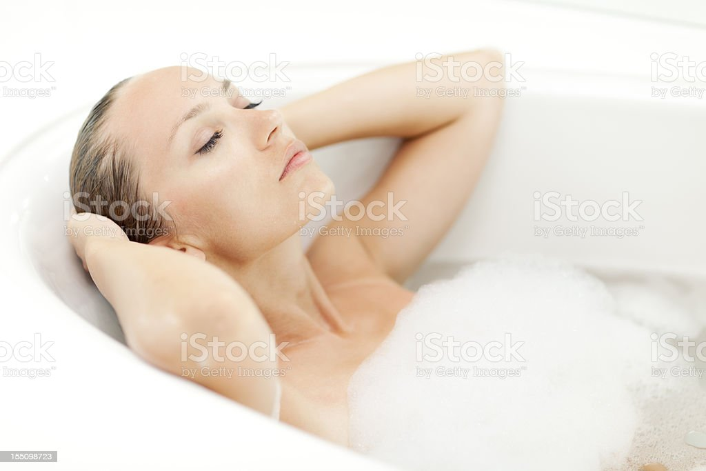 Young attractive woman relaxing in bathtub royalty-free stock photo