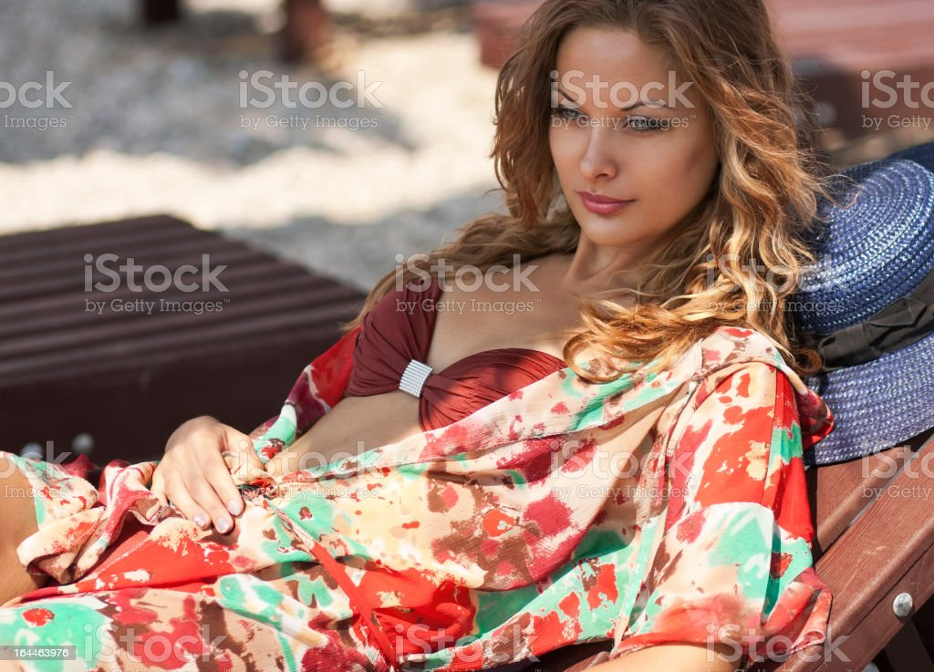 Young attractive woman relaxing on a beach royalty-free stock photo