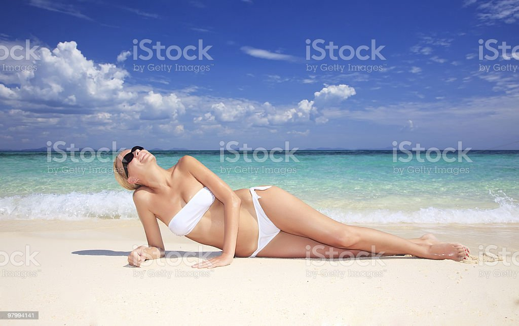 Young attractive woman relaxing on the beach. royalty-free stock photo