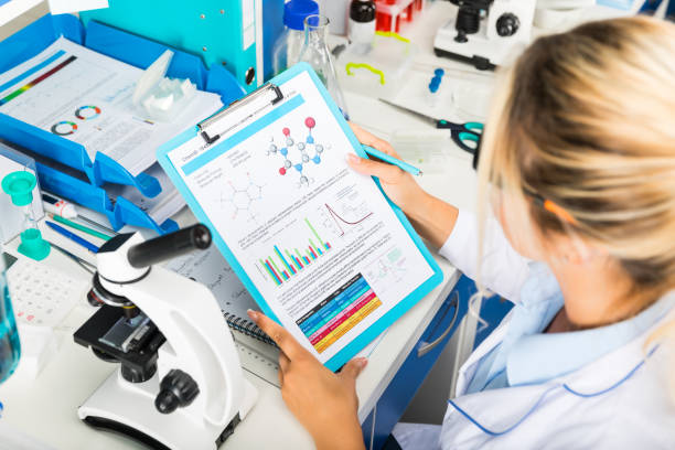 Young attractive woman scientist researching in the laboratory stock photo