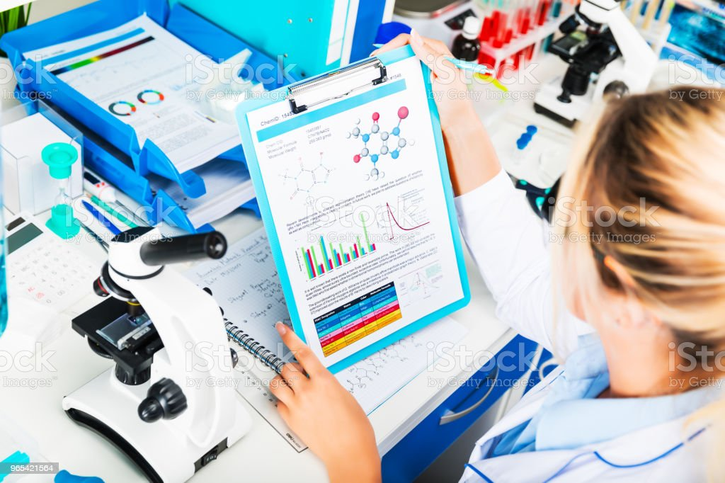 Young attractive woman scientist researching in the laboratory royalty-free stock photo