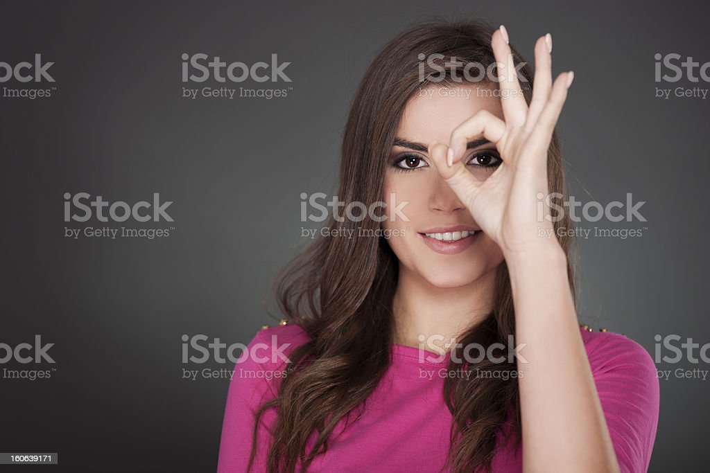 Young attractive woman showing OK stock photo