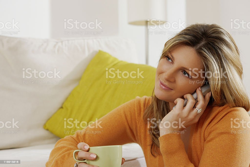 young attractive woman talking on the telephone at home royalty-free stock photo