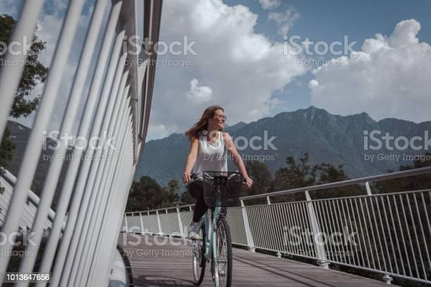 Young attractive woman with bicycle on a bridge picture id1013647656?b=1&k=6&m=1013647656&s=612x612&h=n19y zjykyofq7kjbyexu knyvzanixn9mdojcxlkzo=