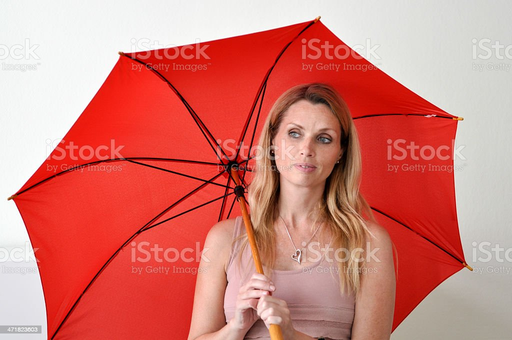 Young attractive woman with red umbrella royalty-free stock photo