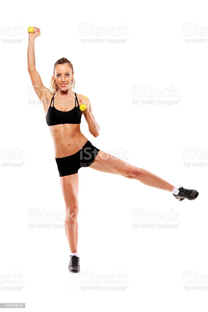 Young attractive woman with weights royalty-free stock photo