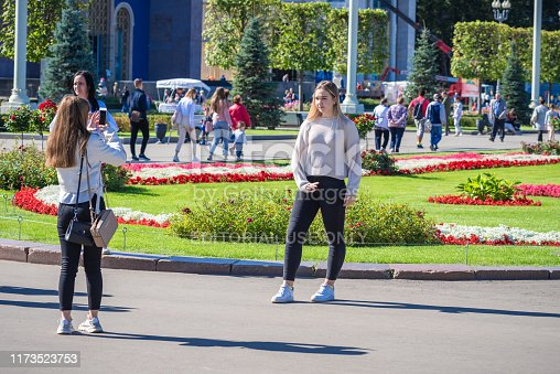 Moscow, Russia, August 28, 2019 - Young attractive women are photographed on a background of flower beds