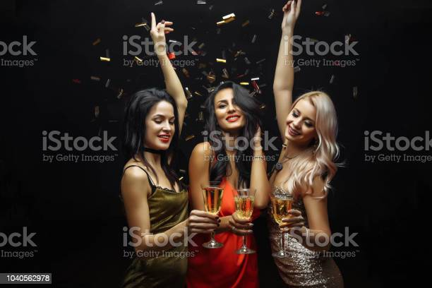 Young attractive women celebrating a party drinking champagne and picture id1040562978?b=1&k=6&m=1040562978&s=612x612&h=wsn6d7lcn5sck56xd44m4ijhqngrj48jokubyub6qqa=