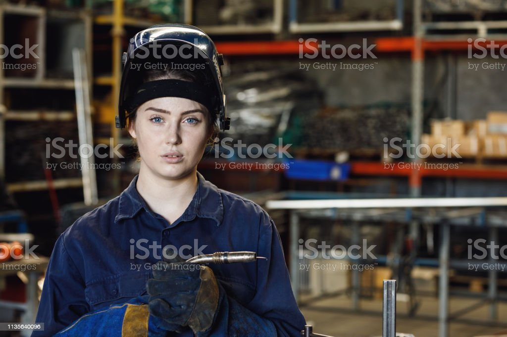 Young Female Australian apprentice trainee welder working in metal...