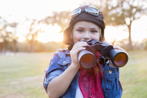 Young aviator using binoculars